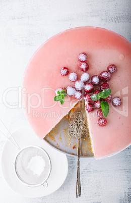 Raspberry yogurt cake with berries on a table.