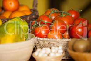 Juicy tomatoes and fruits in organic section