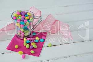 Mug filled with colorful chocolate Easter eggs