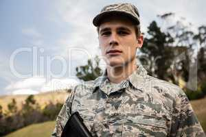 Portrait of military soldier guarding with a rifle