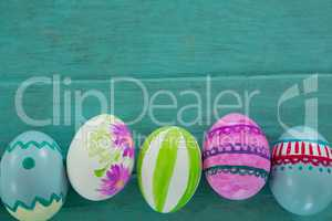 Painted Easter eggs on wooden surface
