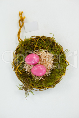 Pink Easter eggs in the nest