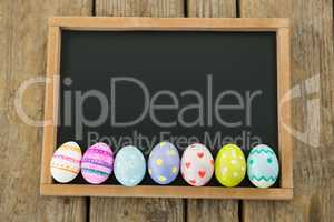 Painted Easter eggs on black background