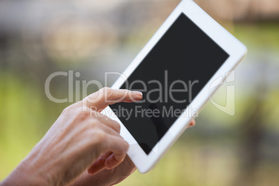 Hands of female staff using digital tablet