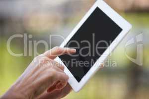 Hands of female staff using digital tablet