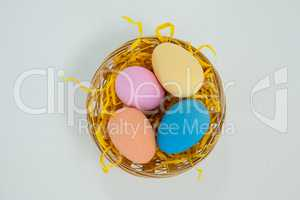 Painted easter eggs in basket