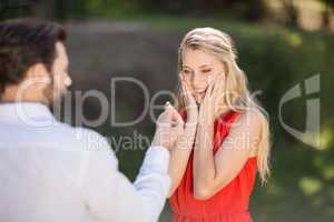 Woman surprised after seeing the ring