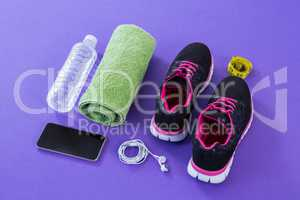 Sneakers, water bottle, towel, measuring tape, mobile phone and headphones