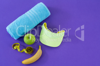 Towel, apple, towel, sun hat and measuring tape