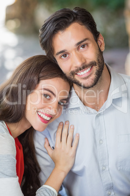 Woman resting her head on mans shoulder in the restaurant