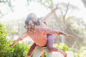 Man giving piggyback ride to woman