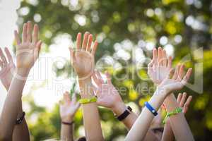 Friends raising their hands while dancing at music festival