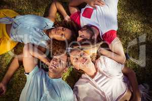 Friends relaxing on grass in park