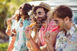 Group of friends eating ice lolly