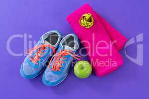 Sneakers, apple, towel and measuring tape