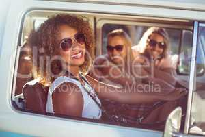 Happy woman driving a campervan