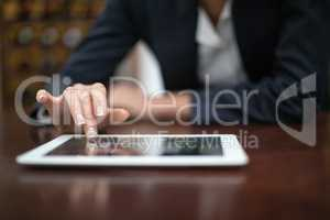 Businesswoman using digital tablet in a restaurant