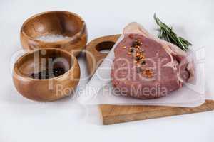 Sirloin chop, salt and black pepper