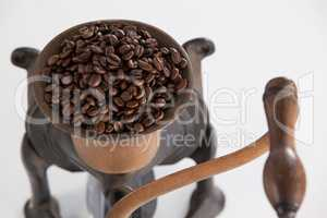 Vintage coffee grinder with coffee beans