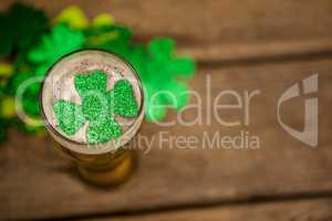 Glass of beer and shamrock for St Patricks Day