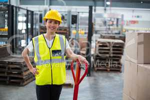 Portrait of female worker standing with hand on hip