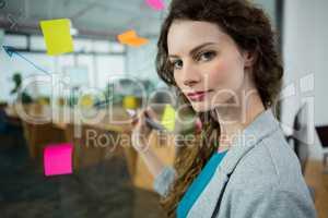 Female executive writing on sticky notes