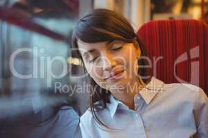 Businesswoman sleeping while travelling