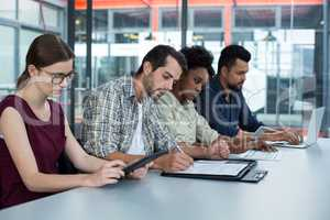 Group of business executives working during meeting