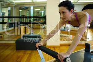 Determined woman practicing stretching exercise