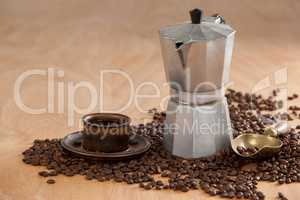 Coffee beans, coffee, coffeemaker and scoop