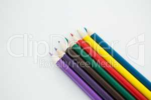 Colored pencils arranged in a row