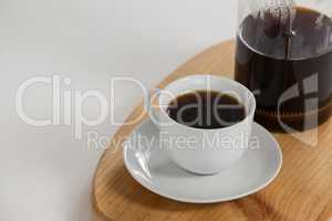 Cafetiere and a cup of black coffee
