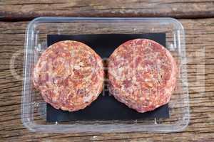 Meat patty in plastic box