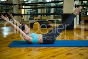 Beautiful woman performing stretching exercise