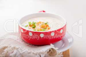 A bowl of creamy cauliflower soup with shrimps.