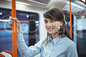 Executive smiling while traveling in train