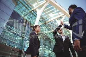 Businesses executives giving high five to each other