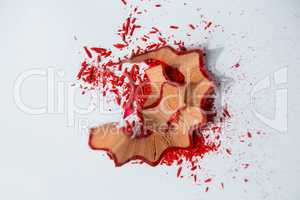 Red color pencils shavings on a white background