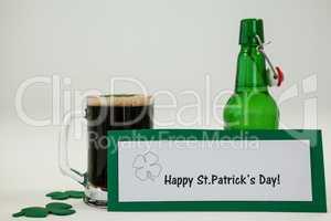 Mug of black beer and shamrock for St Patricks Day