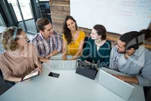 Business executives discussing with each other in meeting