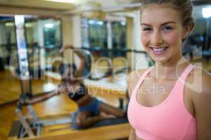 Portrait of fit woman in fitness studio