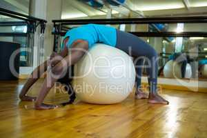 Fit woman exercising on fitness ball