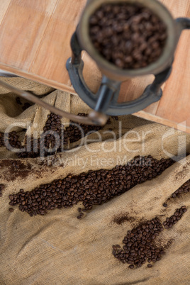 Coffee beans on sack textile with coffee grinder