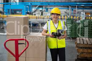 Portrait of smiling female worker using a digital tablet