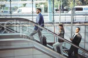 Businesspeople on escalator