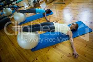 Women exercising on fitness ball