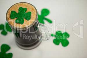 Mug of black beer and shamrock for St Patrick\s Day