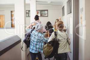 Group of classmate running in corridor