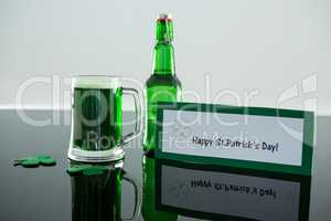 Green beer with shamrock and placard of St Patricks Day