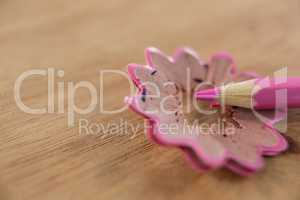 Close-up of pink color pencil with pencil shaving